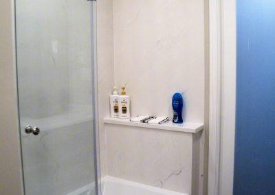 Cultured marble, grey veining, lami glass pocket door